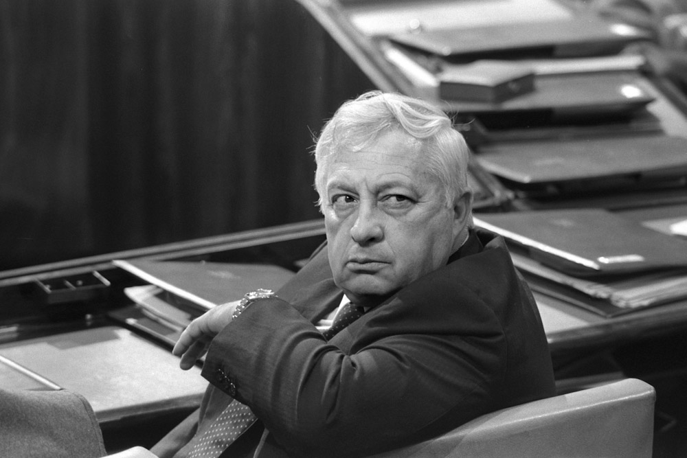 Israel's Minister of Industry and Trade Ariel Sharon sits in a session of Israel's parliament in Jerusalem May 6, 1985 in this file photo released by the Government Press Office. Ariel Sharon passed away on January 11, 2014 at the age of 85. REUTERS/Nati Harnik/Government Press Office/Handout/Files (JERUSALEM - Tags: OBITUARY POLITICS) ATTENTION EDITORS - FOR EDITORIAL USE ONLY. NOT FOR SALE FOR MARKETING OR ADVERTISING CAMPAIGNS. THIS IMAGE HAS BEEN SUPPLIED BY A THIRD PARTY. IT IS DISTRIBUTED, EXACTLY AS RECEIVED BY REUTERS, AS A SERVICE TO CLIENTS. ISRAEL OUT. NO COMMERCIAL OR EDITORIAL SALES IN ISRAEL